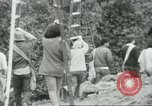 Image of Mexican American orange pickers Farmersville California USA, 1968, second 9 stock footage video 65675058041
