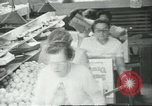 Image of Packaging oranges for sale Farmersville California USA, 1968, second 10 stock footage video 65675058043