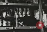 Image of rationing of food United States USA, 1943, second 9 stock footage video 65675058157