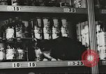 Image of rationing of food United States USA, 1943, second 12 stock footage video 65675058157