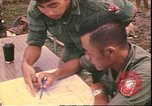 Image of Vietnamese officer Vietnam, 1970, second 9 stock footage video 65675058214