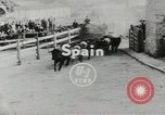 Image of running bulls Pamplona Spain, 1953, second 2 stock footage video 65675058246