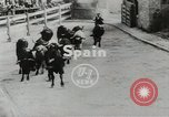 Image of running bulls Pamplona Spain, 1953, second 4 stock footage video 65675058246