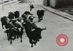 Image of running bulls Pamplona Spain, 1953, second 5 stock footage video 65675058246