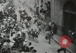 Image of running bulls Pamplona Spain, 1953, second 12 stock footage video 65675058246