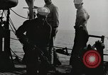 Image of planes dive bombing beach Pacific Theater, 1943, second 5 stock footage video 65675058376