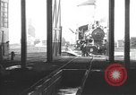 Image of Steam locomotive undergoing maintenance in roundhouse United States USA, 1923, second 1 stock footage video 65675058512