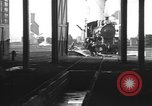 Image of Steam locomotive undergoing maintenance in roundhouse United States USA, 1923, second 2 stock footage video 65675058512