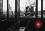 Image of Steam locomotive undergoing maintenance in roundhouse United States USA, 1923, second 4 stock footage video 65675058512