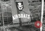 Image of airboat Vietnam, 1967, second 6 stock footage video 65675058586
