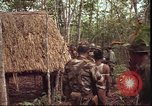 Image of thatched roof hut Pleiku South Vietnam, 1966, second 8 stock footage video 65675058783