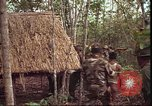 Image of thatched roof hut Pleiku South Vietnam, 1966, second 9 stock footage video 65675058783