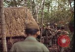 Image of thatched roof hut Pleiku South Vietnam, 1966, second 11 stock footage video 65675058783