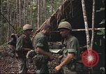 Image of thatched roof hut Pleiku South Vietnam, 1966, second 12 stock footage video 65675058783