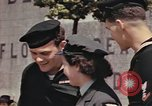 Image of American soldiers board landing craft at English port England, 1944, second 7 stock footage video 65675058887