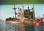 Image of damaged ship Manila Philippines, 1945, second 1 stock footage video 65675058923