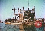 Image of damaged ship Manila Philippines, 1945, second 2 stock footage video 65675058923