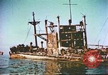 Image of damaged ship Manila Philippines, 1945, second 4 stock footage video 65675058923
