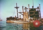 Image of damaged ship Manila Philippines, 1945, second 8 stock footage video 65675058923