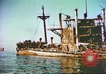 Image of damaged ship Manila Philippines, 1945, second 10 stock footage video 65675058923