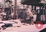 Image of Filipino civilians Manila Philippines, 1945, second 1 stock footage video 65675058930