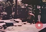 Image of Filipino civilians Manila Philippines, 1945, second 2 stock footage video 65675058930