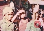 Image of Filipino civilians Manila Philippines, 1945, second 1 stock footage video 65675058931