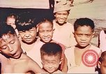 Image of Filipino civilians Manila Philippines, 1945, second 6 stock footage video 65675058931