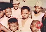 Image of Filipino civilians Manila Philippines, 1945, second 7 stock footage video 65675058931