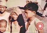 Image of Filipino civilians Manila Philippines, 1945, second 10 stock footage video 65675058931