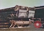 Image of damaged landing crafts Manila Philippines, 1945, second 11 stock footage video 65675058932