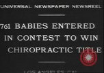 Image of chiropractors examining babies Los Angeles California USA, 1931, second 9 stock footage video 65675058948