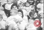 Image of chiropractors examining babies Los Angeles California USA, 1931, second 10 stock footage video 65675058948