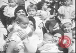 Image of chiropractors examining babies Los Angeles California USA, 1931, second 11 stock footage video 65675058948