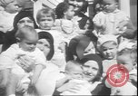 Image of chiropractors examining babies Los Angeles California USA, 1931, second 12 stock footage video 65675058948