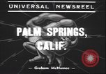 Image of underwater wrestling Palm Springs California USA, 1939, second 2 stock footage video 65675059010