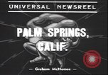 Image of underwater wrestling Palm Springs California USA, 1939, second 4 stock footage video 65675059010
