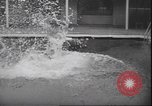Image of underwater wrestling Palm Springs California USA, 1939, second 10 stock footage video 65675059010