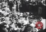 Image of dead body of Mussolini Milan Italy, 1945, second 5 stock footage video 65675059045