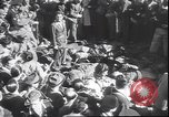 Image of dead body of Mussolini Milan Italy, 1945, second 7 stock footage video 65675059045