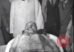 Image of dead body of Mussolini Milan Italy, 1945, second 11 stock footage video 65675059051