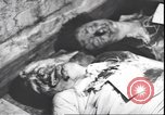 Image of dead body of Mussolini Milan Italy, 1945, second 2 stock footage video 65675059082