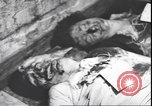 Image of dead body of Mussolini Milan Italy, 1945, second 3 stock footage video 65675059082