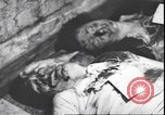 Image of dead body of Mussolini Milan Italy, 1945, second 6 stock footage video 65675059082