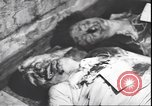 Image of dead body of Mussolini Milan Italy, 1945, second 8 stock footage video 65675059082