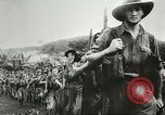 Image of Wounded Australian troops at the front during World War 2 Kokoda New Guinea, 1942, second 8 stock footage video 65675059615