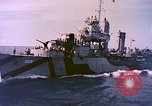 Image of USS Drayton (DD-366) in camouflage paint off coast of Iwo Jima Pacific Ocean, 1944, second 3 stock footage video 65675059676