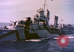 Image of USS Drayton (DD-366) in camouflage paint off coast of Iwo Jima Pacific Ocean, 1944, second 5 stock footage video 65675059676
