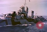 Image of USS Drayton (DD-366) in camouflage paint off coast of Iwo Jima Pacific Ocean, 1944, second 6 stock footage video 65675059676