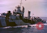 Image of USS Drayton (DD-366) in camouflage paint off coast of Iwo Jima Pacific Ocean, 1944, second 8 stock footage video 65675059676